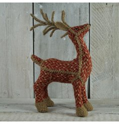 Natural woven reindeer decorations in festive red and cream colours. Unique and charming items.