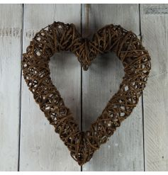 A charming shabby chic rattan heart in a dark natural colour.