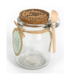 Glass storage jar with decorative cork lid and spoon to match