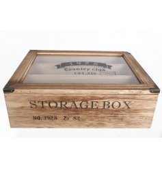 A chunky wooden storage box with a stylish 1928 country club stamp.