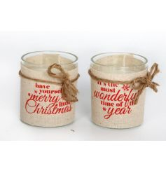 An assortment of 2 festive candle holders with red and natural linen wraps.