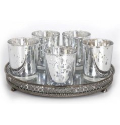 Set of 5 candle holders on a chic mirror base
