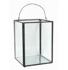 Chic candle holder with glass panels and metal frame with handle to hang