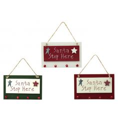 An assortment of 3 festive wooden signs with bell decorations