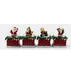 An assortment of 4 water balls with Santa decoration inside