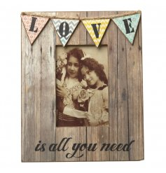 A creative wooden photo frame with jazzy patterned bunting and heartwarming text