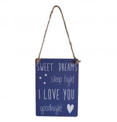 A hanging metal dangler sign with popular sweet dreams quote