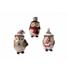 An assortment of 3 festive owl decorations with a glitter finish.