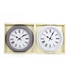 An assortment of 2 round clocks in tonal colours with distressed finish