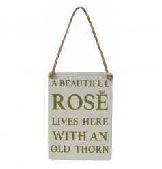 A mini metal garden sign with a rose slogan and jute string to hang.