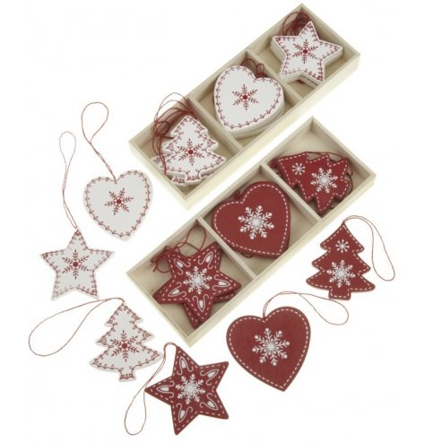 Red and white wooden hanging decorations in tree, heart and star designs. Each is decorated with a nordic pattern
