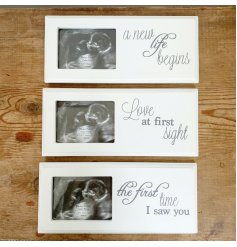 An assortment of 3 classic white baby scan picture frames with sweet text