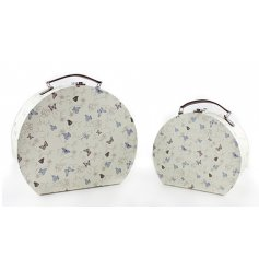 Set of 2 round travel cases with popular Flutterbyes design