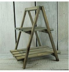 Rustic wooden plant stand in a greywash design