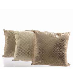An assortment of three fabric cushions in geometric designs