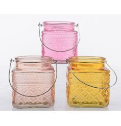 An assortment of three glass candle holders in pretty spring colours
