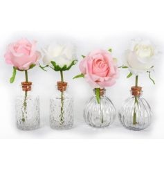 An assortment of 4 glass vases each with satin rose decoration