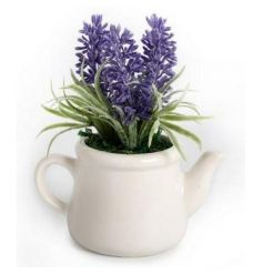Artificial lavender plant in a classic white ceramic teapot