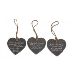 An assortment of three heart decorations with garden text