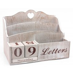 A natural wooden calendar and letter rack storage item
