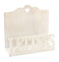 A shabby and chic natural wooden letter rack