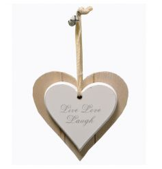 A double wooden heart sign with bell decoration and popular text