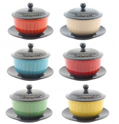 An assortment of 6 colourful soup bowls, each with lid and plate