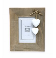 Standing shabby photo frame with solid white heart decorations