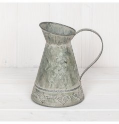Rustic style jug in a zinc material for use in the home