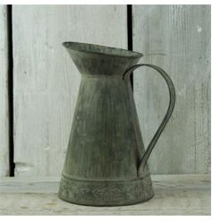 Rustic style vintage jug made from a zinc material