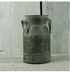A distressed style milk churn for decorative use in the home or garden