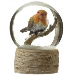 A traditional festive snow globe with a wonderful winter robin.