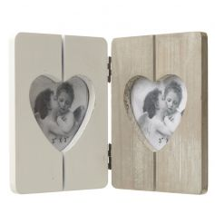 A heart shaped frame in natural and white coloured wood