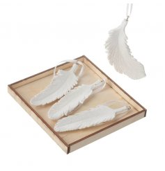 Set of hanging resin feather decorations in a classic white colour