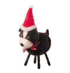 A decorative woollen dog with a festive red hat