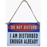 A bold and humorous do not disturb mini metal sign.