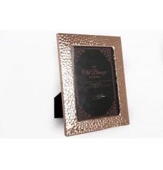 A trendy coppered picture frame with a hammered design