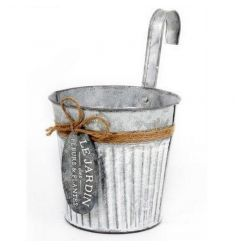 A rustic metal planter for the garden with French tag