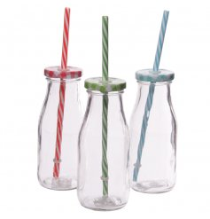 An assortment of three vintage glass bottles with colourful straws
