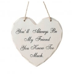 White wooden heart sign with popular Friend script