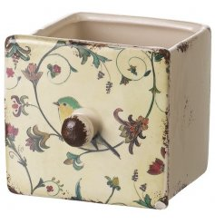 Chic ceramic pot with a pretty bird and floral design