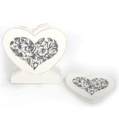 White wooden heart shaped coasters in a heart holder