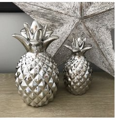 A decorative silver pineapple decoration for the home