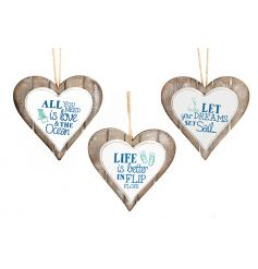 Seaside and ocean text and design on an assortment of three wooden hearts