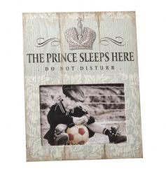Popular Prince Sleeps Here text on a distressed picture frame