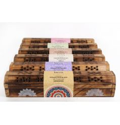 6 assorted scented fragrant incense sticks in decorative wooden boxes.