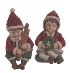 A mix of 2 charming red winter children in a sitting pose.