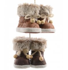 Adorable mini leather boots with fur trim and beaded laces.