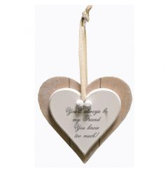 A hanging wooden heart sign with popular Friend quote