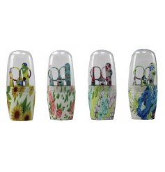 An assortment of four floral manicure sets